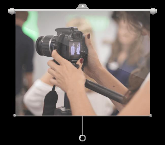 atom42 employee using a professional camera