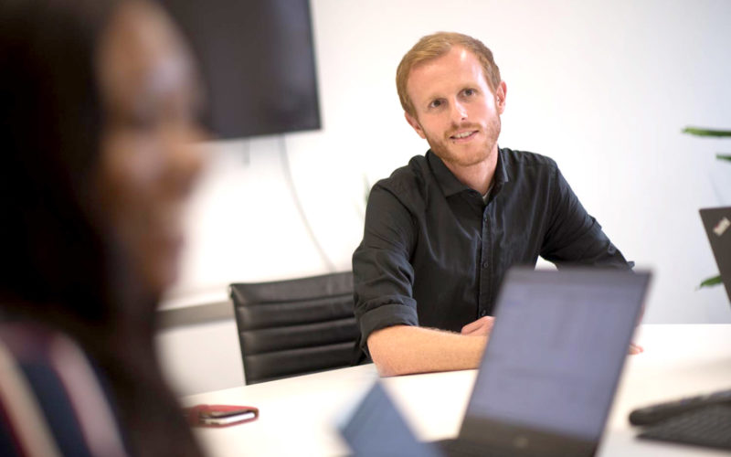 Atom42 team member in a meeting