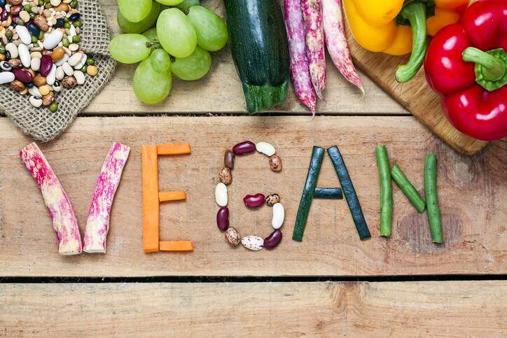 The word 'vegan' spelled out in vegetables