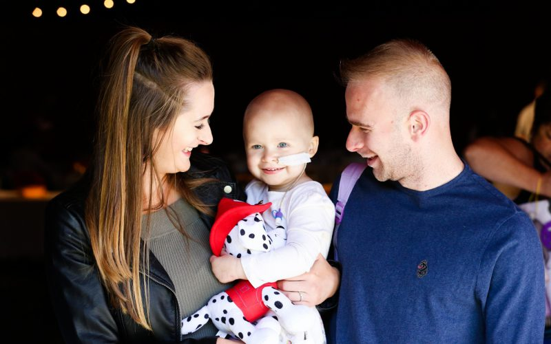 Family embracing child with cancer.