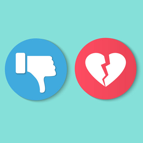 An image displaying a facebook dislike and un-love heart