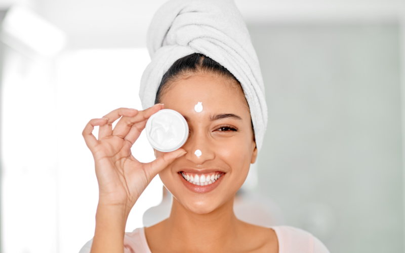 Woman applying skin care products to her face